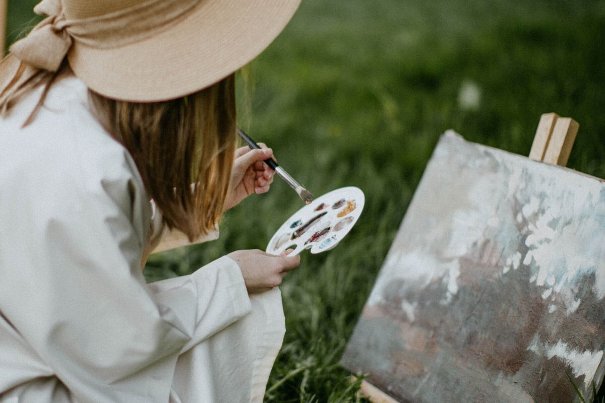 lady with a white hat on painting