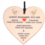 Light pink plaque with writing on