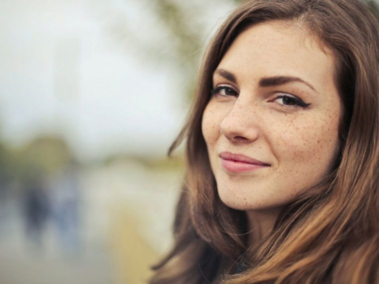 Lady with brown hair looking into the camera