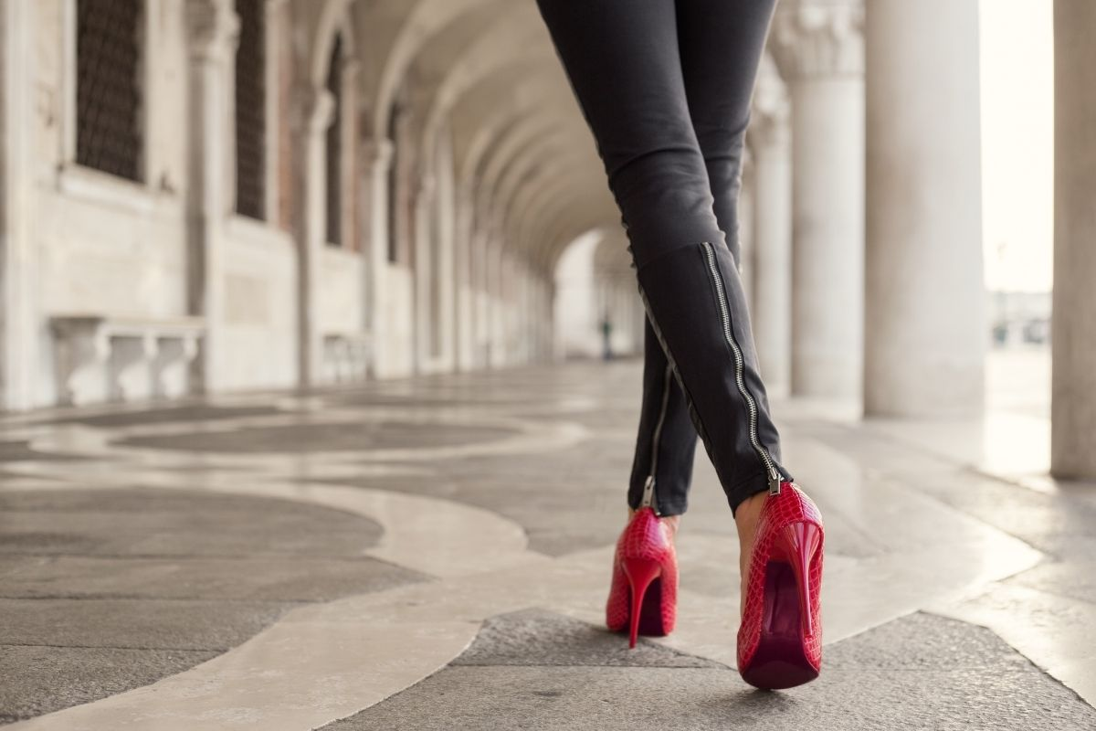 Leather trousers with red heels