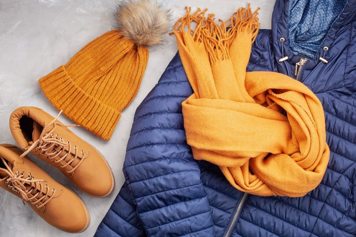Orange hat, boots and scarf on a blue coat