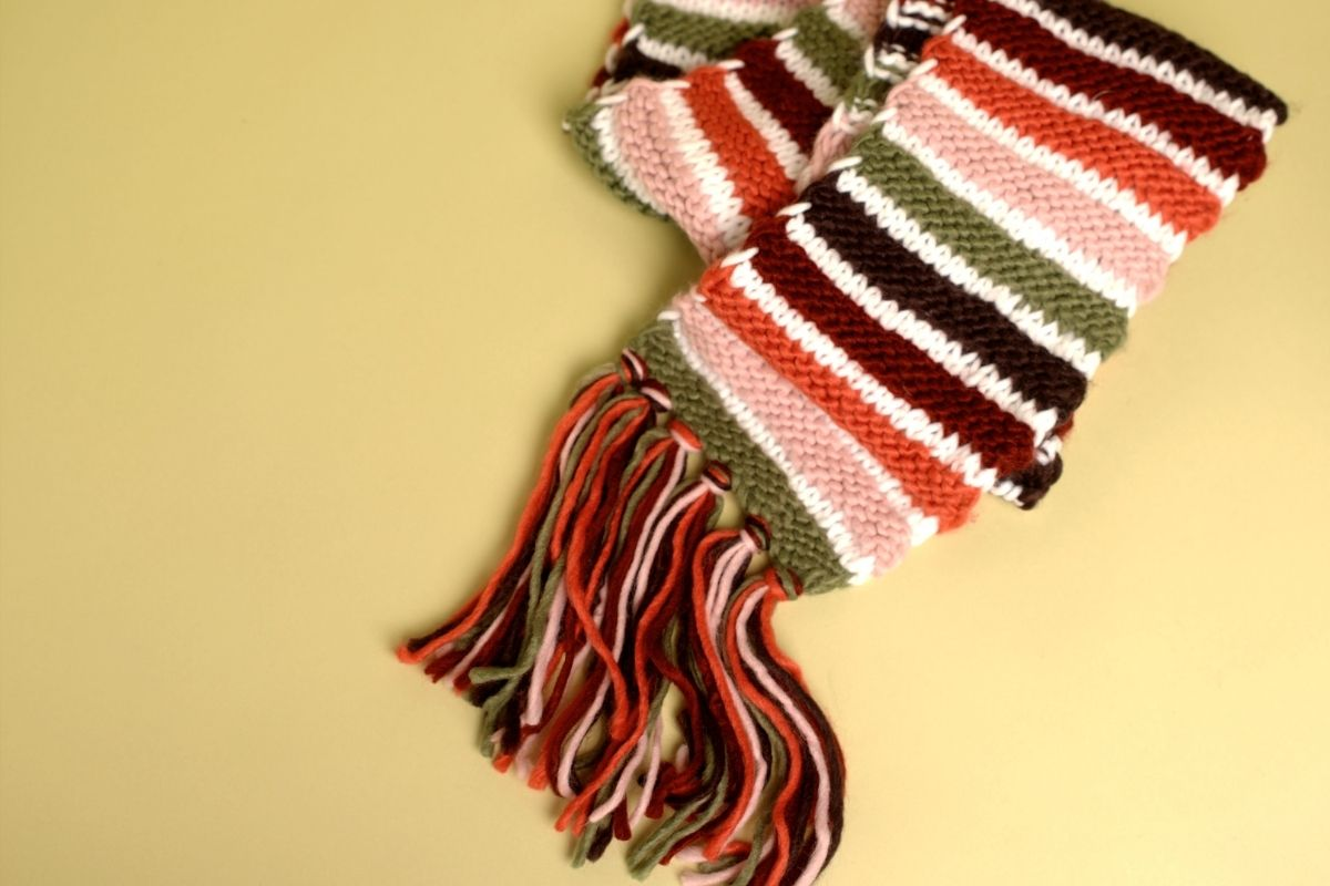 Stripy scarf on a yellow background