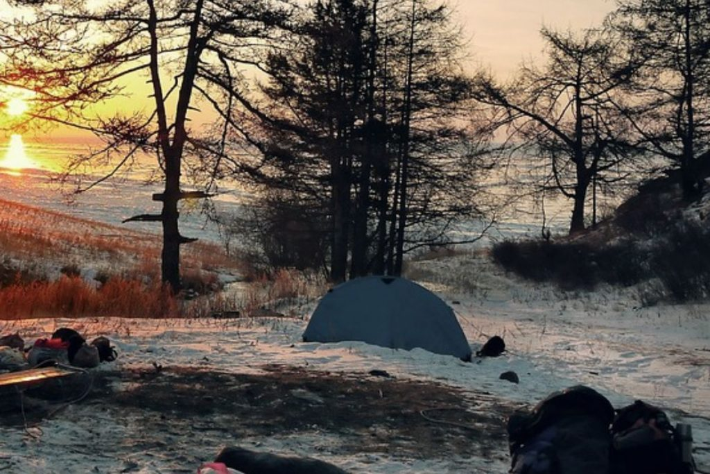 Tent in the middle of a snowy forest