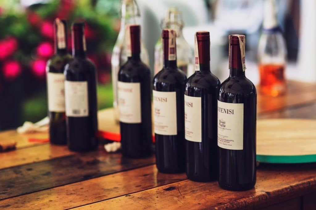 Red wine bottles lined up