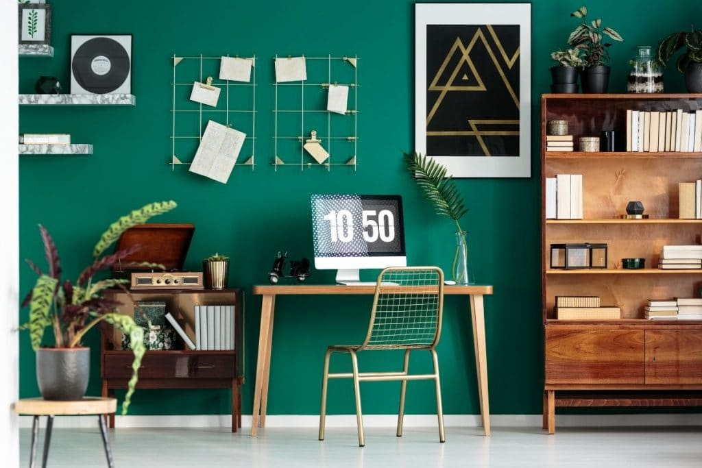 Green walls with a desk and computer