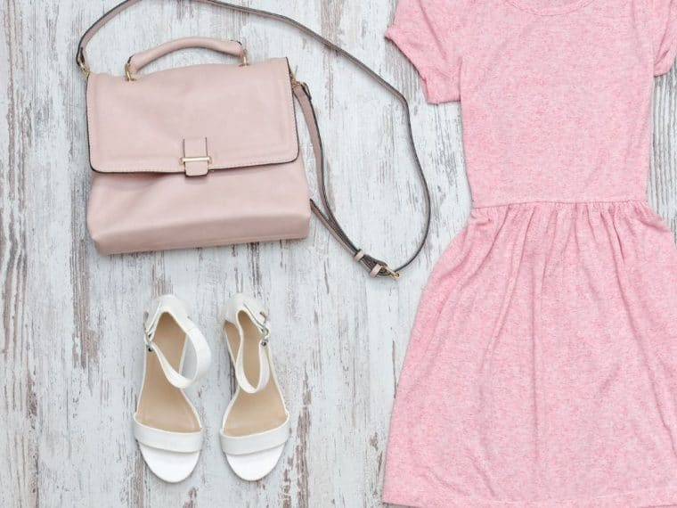 Pink dress with a pink handbag and white sandals