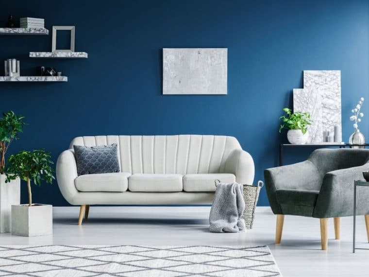 Blue background with sofa
